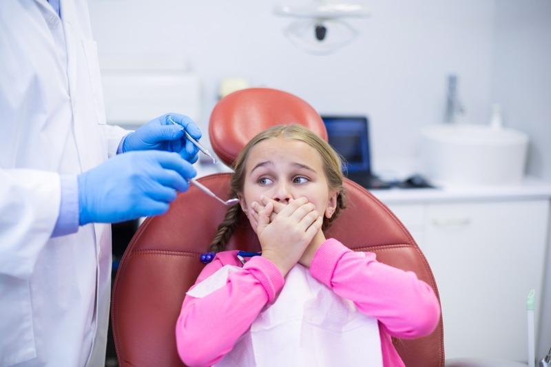 Cómo curar un flemón dental en niños